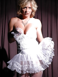 Lusty darling in ruffled white dress