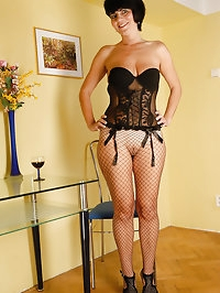 Elegant looking Eve in fisnet stockings bares her fine..