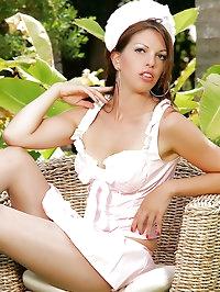 Sexy nurse poses seductively