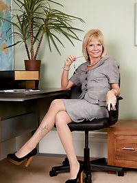 Secretary strips in the office and bends over exposing her..
