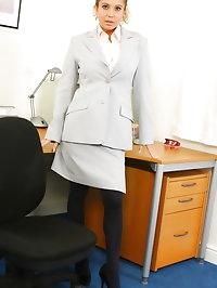 Brooke W wearing a grey secretary suit with black..
