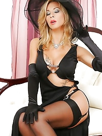 Attractive vixen dazzles in black outfit