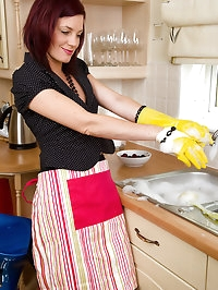 Beautiful redheaded MILF Sofia busy in the kitchen with..