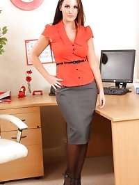 Eva in the office revealing her red lingerie & suspenders