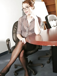 Office babe Samantha strips into dark stockings