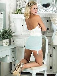 Vanessa strips off her full skirted dress to pose..