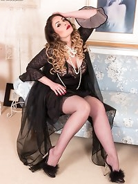 Looking glamorous in vintage robe and sexy black lingerie..