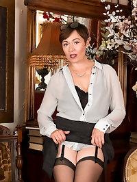 A miniskirt and button down shirt present a modest..