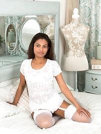 Dressed all in white, dusky mom Alishaa Mae puts her 36..