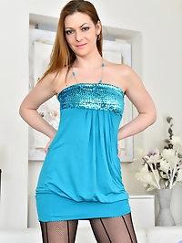 Naughty housewife MIschelle peels off her miniskirt dress..