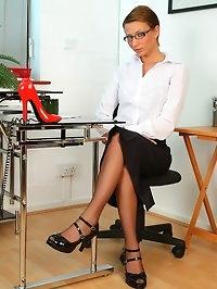 Secretary Katie-Lee in stockings and 8 strap suspenders