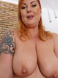 Curvy housewife showing off her great boobs