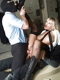 A sexy blonde in uniform satisfies two cocks