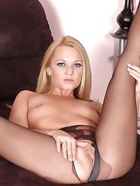 Blonde feels horny in black pantyhose