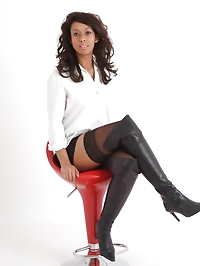 See this dark haired beauty strip down to just her boots..