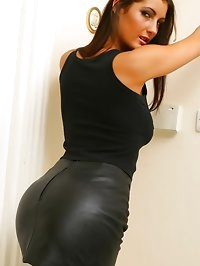 Emma T looking beautiful in a sexy leather miniskirt and..