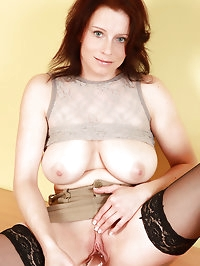 Redheaded and busty mature Carol from toying her meaty pussy