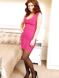Kelly H in pink dress and stockings