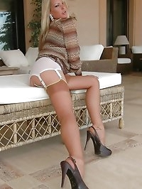 Blonde darling has sexy legs in stockings