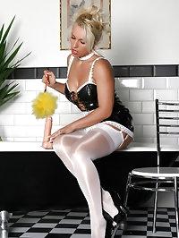 Saucy Lana dressed as a naughty maid and masturbating