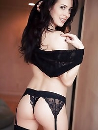 Dark haired beauty wearing sheer lingerie and opaque..