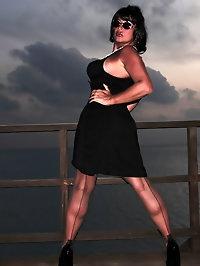 Busty darling wears a black dress