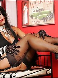 Lusty vixen wears a black ensemble
