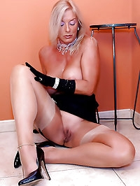 Sexy MILF Astrid shows big tits and pussy in girdle and..