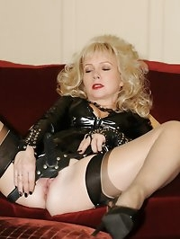 stockinged milf plays with unusual strapon