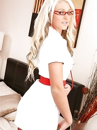 Blonde nurse slips out of the uniform and shows off sexy..