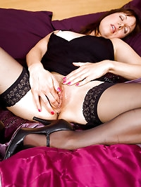 Gorgeous 43 year old Cindy slips her fingers into her..