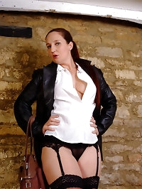 Sexy Mistress Sammi takes out her leather gloves, gun and..