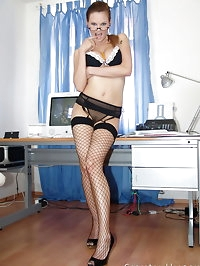 Busty hot secretary Tarra in black fishnets