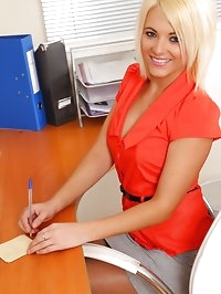 Gorgeous blonde teases in her office uniform and red..