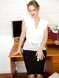 Office MILF Tara Trinity takes a break from her work to..