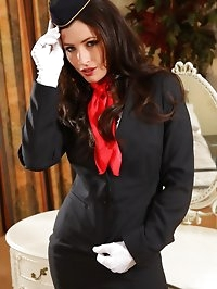 Gorgeous dark haired air hostess teases in her tight skirt..