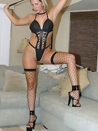 Black Fishnets, 7 inch heels, Leather Teddy & Paddle