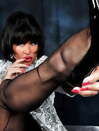 Dark-haired tramp has stockings fascination
