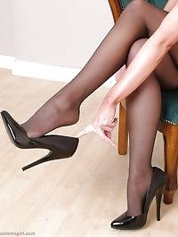 Cute brunette teasing her hot body in black lingerie and..
