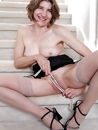 56 year old Bossy Ryder from AllOver30 opens her legs on..
