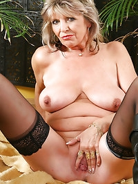 Cute 50 year old grandma gets nude and fingers herself for..