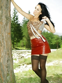 Penelope looking stunning in a sexy leather miniskirt,..
