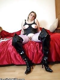 Kinky tied up wife in rubber and thigh boots waits to be..