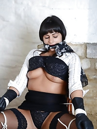 Busty Simone teases her master with her gorgeous leather..