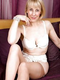 63 year old Hazel pulls her panties aside to display a..