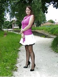 Leggy brunette wearing black nylons and high heel shoes