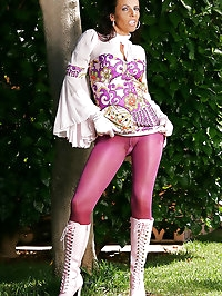 Purple tights complete her ensemble