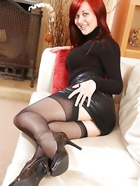 Lisa in the lounge in leather mini skirt