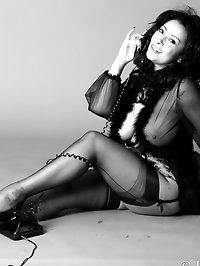 Danica Collins in corset and stockings in retro black and..