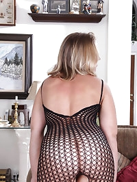 Horny blonde MILF Chance posing sexy in her black fishnet..